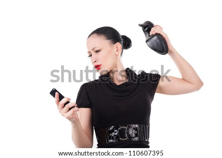 Woman smash her smartphone with her shoe - stock photo
