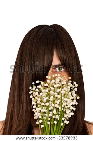 woman smelling bouquet of lilies of the valley - stock photo