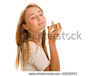 Woman smelling perfume - stock photo