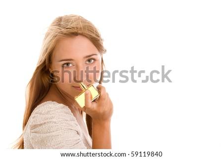 Woman smelling perfume on white background - stock photo