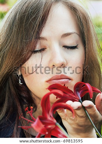 woman smelling red tiger lily