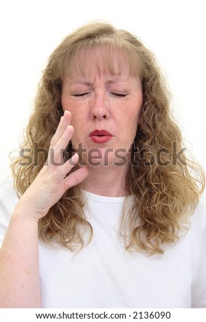 Woman smells something really bad and is grimacing in disgust. Isolated on white. - stock photo
