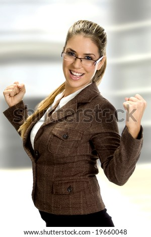 woman smiling and enjoying in happiness of success on an abstract background - stock photo