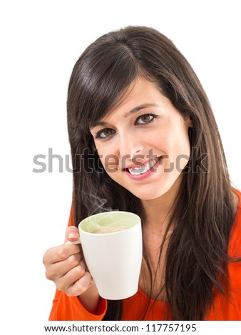 Woman smiling and holding a hot cup of steaming coffee with one hand. Isolated on white. - stock photo