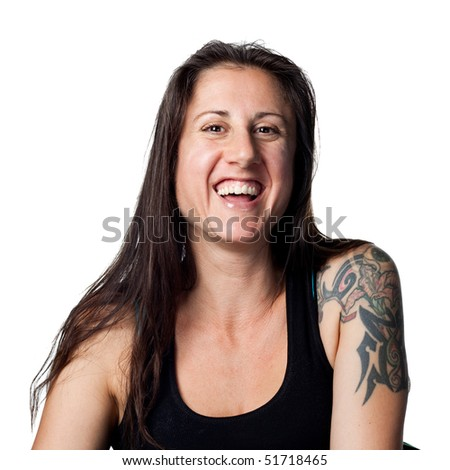 Woman smiling and laughing at the camera