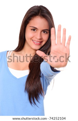 Woman smiling and showing his hand in signal of stop - stock photo