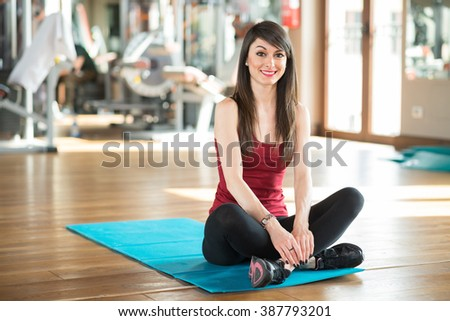 Woman smiling in a gym - stock photo