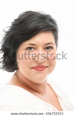 Woman smiling in pleasure Woman smiling in pleasure and joy, happy and contented with her life - stock photo