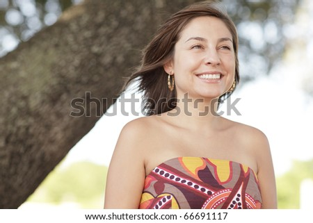 Woman smiling in the park - stock photo