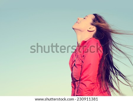 Woman smiling looking up to blue sky taking deep breath celebrating freedom. Positive human emotion face expression feeling life perception success peace mind concept. Free Happy girl enjoying nature - stock photo