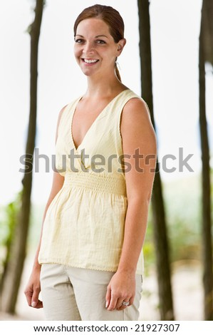 Woman smiling outdoors - stock photo