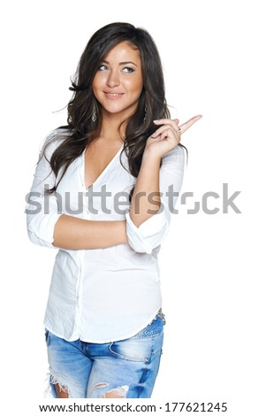 Woman smiling pointing up showing copy space, isolated on white background. - stock photo