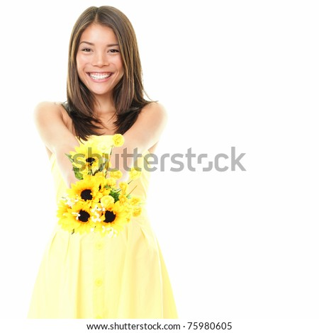 Woman smiling showing yellow flowers isolated on white background. Beautiful fresh young mixed race Asian Caucasian female model in cute summer dress. - stock photo