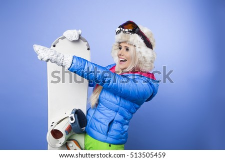 Woman smiling skier girl wearing fur vest ski googles. Winter sport activity.