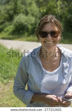 Woman smiling, Wasagaming, Riding Mountain National Park, Manitoba, Canada - stock photo