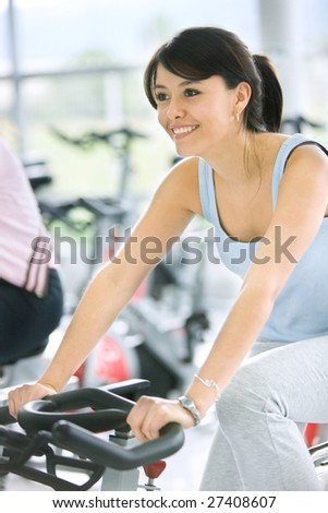 woman smiling while doing in a gym