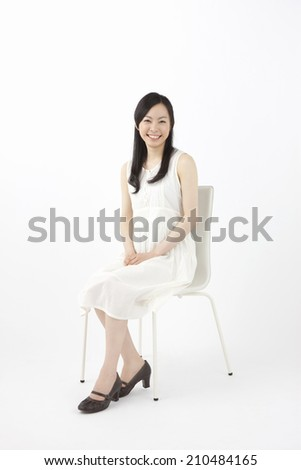 Woman smiling while sitting in a chair