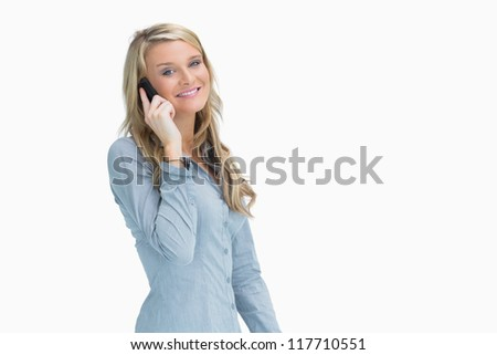 Woman smiling while talking on the mobile phone - stock photo