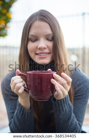 Woman Smiling with Cup