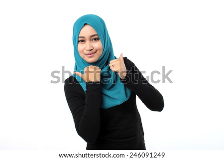 woman smiling with good hand sign - stock photo