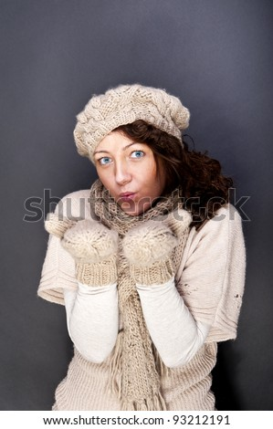 woman smiling with hat and gloves on her