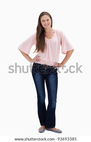 Woman smiling with her hands on the hips against white background - stock photo