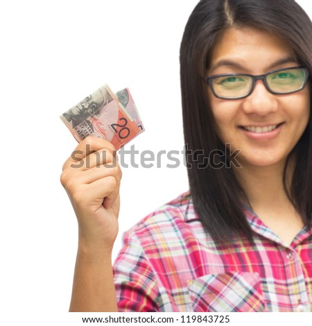 Woman smiling with money cash in hand - stock photo