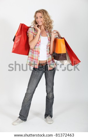 Woman smiling with shopping bags - stock photo