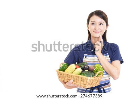 Woman smiling with vegetables