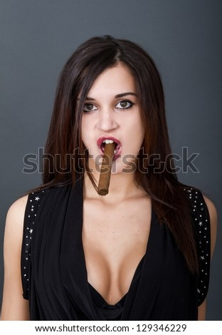 woman smokes cigar