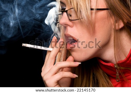 Woman smoking a cigarette macro shot