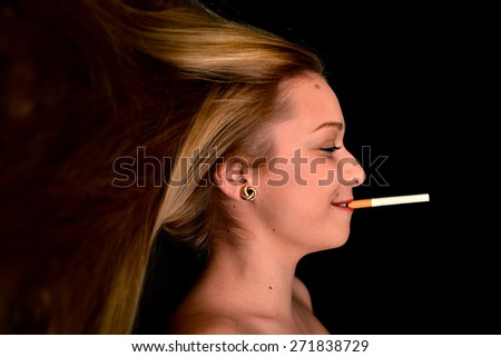 Woman Smoking a Cigarette on Black Background