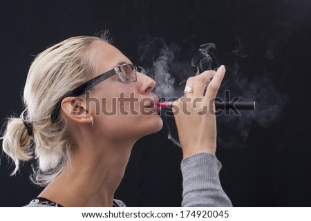 Woman Smoking E-Cigarette - stock photo