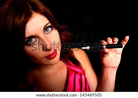 woman smoking e-cigarette with the smoke on the side - stock photo