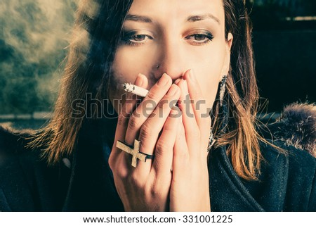 Woman smoking instagram color filter - stock photo