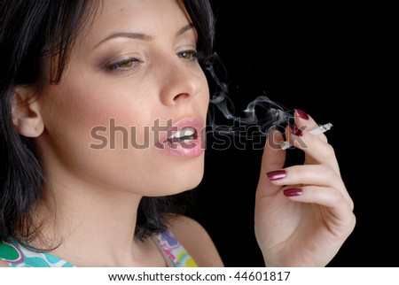 woman smoking on black background