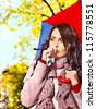 Woman sneezing handkerchief fall outdoor. - stock photo
