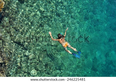 Woman snorkeling at Phi Phi Island, Phuket, Thailand - stock photo