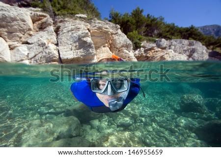Woman snorkeling in a sea - stock photo