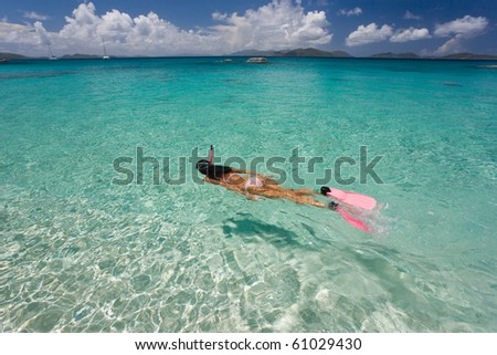 woman snorkeling in tropical water on vacation - stock photo