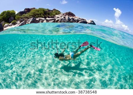 woman snorkeling underwater in caribbean islands - stock photo