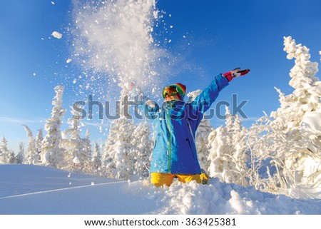 Woman snowboarder having fun
