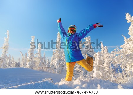 Woman snowboarder having fun in a fantastic winter forest.