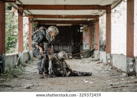 woman  soldiers evacuate the injured fellow in arms in the tonnel - stock photo