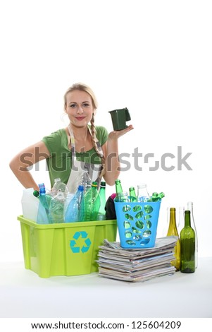 Woman sorting through the recycling
