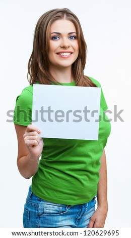 Woman sowing blank card. Isolated on white background smiling female portrait . Green color dressed. - stock photo