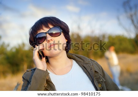 woman speaking on mobile phone - stock photo