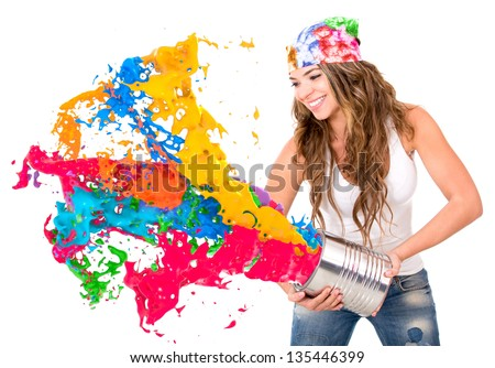 Woman splashing colorful paint from a can - isolated over white background - stock photo