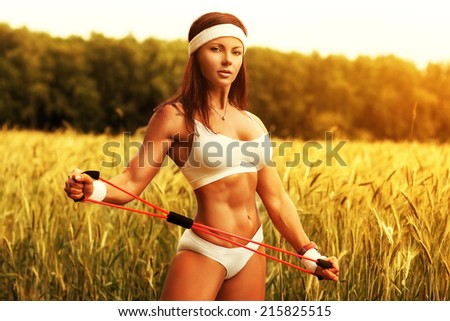 Woman sports training at summer field. - stock photo