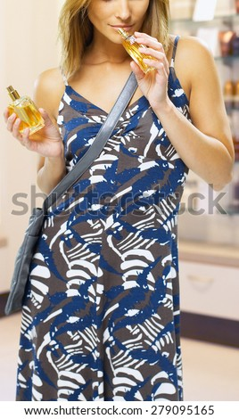 woman spraying perfume - stock photo